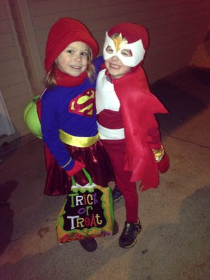 Isabelle Knutson, dressed as Supergirl, and Jameson Zinda, dressed as Falcon, trick-or-treat in Rosholt. Her parents are Amy and Braden Knutson. His parents are Nancy and Jason Zinda.