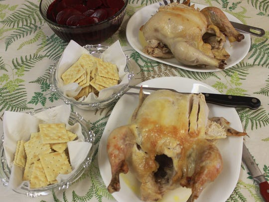 Whole chickens are sliced and served either in the soup or on the side. The crackers are a nod to those who don't want biscuits.