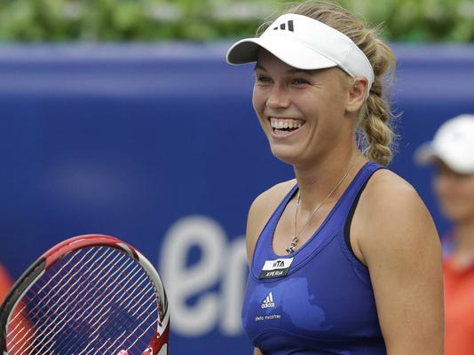 9-12-12 Wozniacki smiles after win vs zakapalova