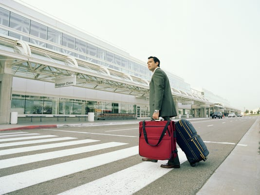 Businessman luggage airport road