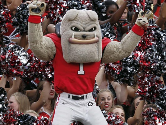 Georgia mascot hairy dawg celebrates with cheerleaders after the