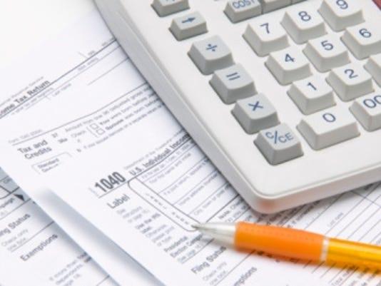 taxes calculator pen thinkstock