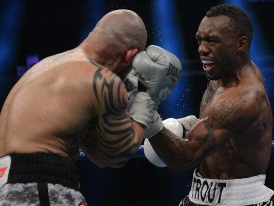 Trout beats Cotto