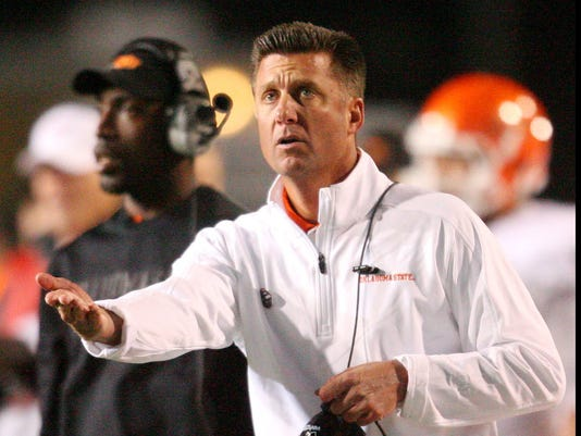 2012-12-04_MikeGundy_coachingsearches