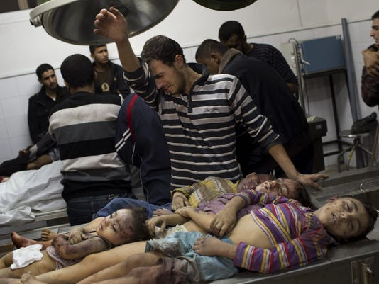 Palestinian children crying man morgue