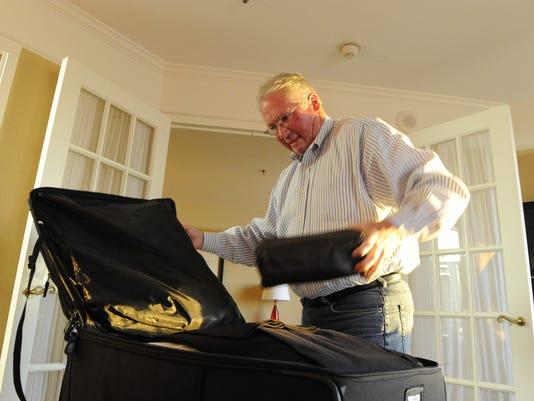 Packing suitcase Bob Johnson