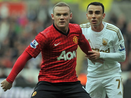 2012-12-26-wayne-rooney-knee-injury
