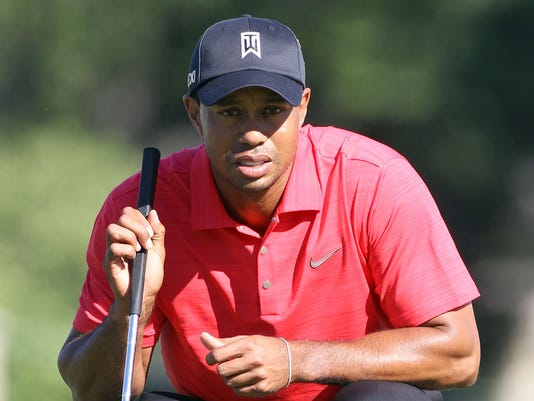 1 22 2013 Tiger Woods crouch