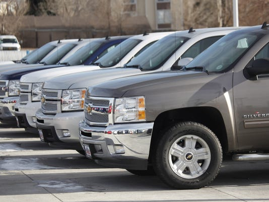 In this file photograph taken on Sunday, Jan. 20, 2013, a long line of 2013 Silverado pickup turcks sit at a Chevrolet dealership in Englewood, Colo. (AP Photo/David Zalubowski) ORG XMIT: OTKDZ112