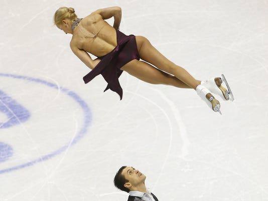 2013-3-13-tatiana-volosozhar-maxim-trankov-skating-worlds