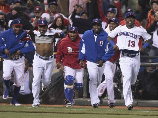 2013-03-19-world-baseball-classic-dominicans-celebrate