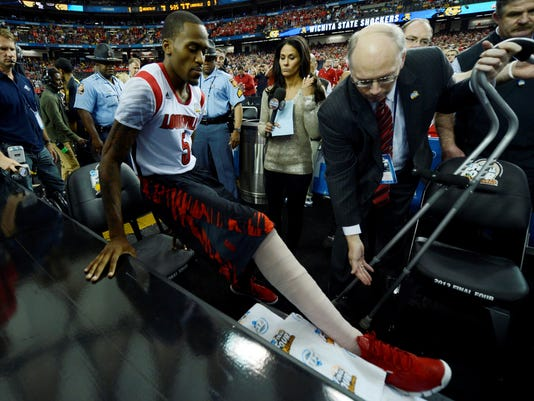 Kevin Ware cheers from courtside at the Final Four