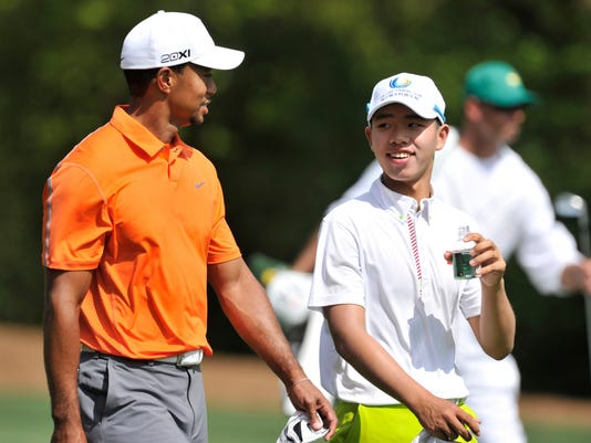 2013-4-8 guan and tiger woods