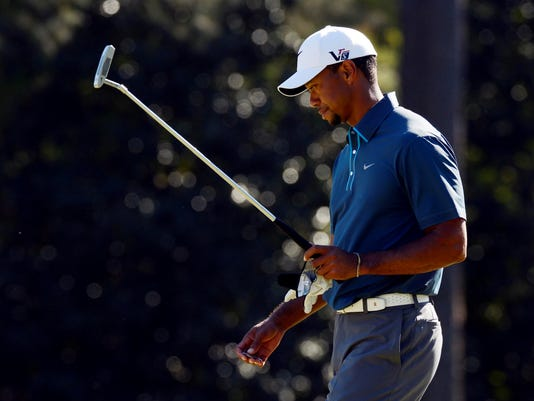 2013-04-13-Tiger-Woods-contemplate