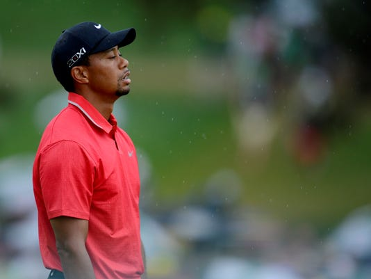 2013-04-14-tiger-woods-face-miss