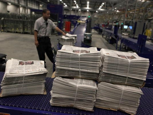 newspapers stacked 2009 getty