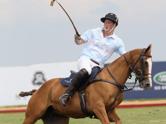 Prince Harry plays polo