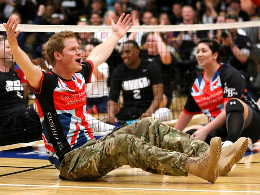 Prince Harry competes in volleyball