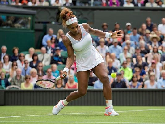 2013-6-25 serena williams hits a forehand