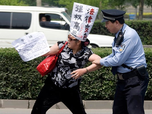 AP China Clamping Dissent