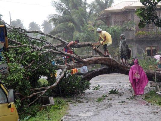 powerful typhoon kills at least 74 in philippines. Black Bedroom Furniture Sets. Home Design Ideas