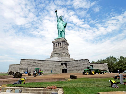 Statute of Liberty land flooded by superstorm, but now set to reopen ...
