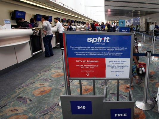 Spirit Airlines may charge baggage fees and make you pay to pick your seat, but there is a strategy to keep prices low and still get the à la carte services you need.