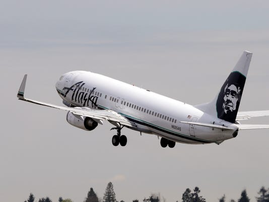 Alaska Airlines Ups Fees For Checked Bags Changes