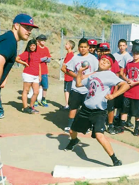 Sixth grade Central Elementary student Alex Holguin tosses the shot put 30 feet during a track meet Tuesday at  Cobre High.