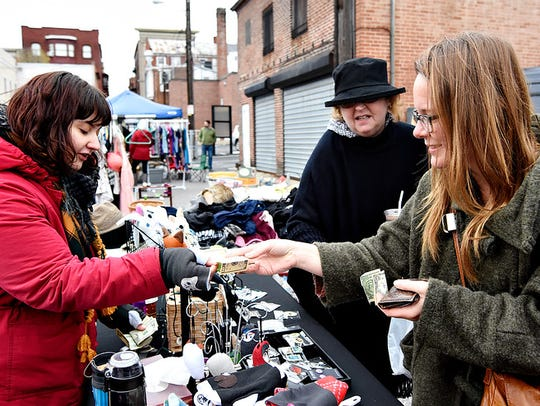 Lindsey Richards, right, of York City, makes a purchase