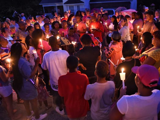 Friends and family gather outside home the home of