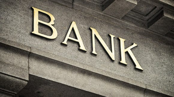 Bank sign on stone facade.
