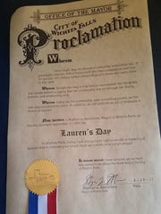Mayor Stephen Santellana approved a proclamation declaring Sept. 2, 2017 as Lauren's Day, asking the community to wear something purple in her memory.