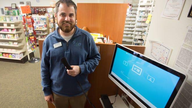 Brett Barker, Vice President of operations at NuCara Pharmacy demonstrates the Telepharmacy tablet in Zearing Thursday, Feb. 25, 2016.