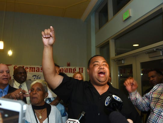 Coleman Young II celebrates at a rally held at the