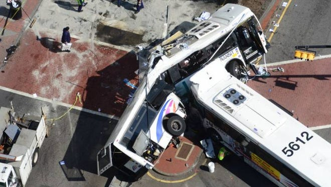 Two NJ Transit commuter buses collided Friday morning in Newark.