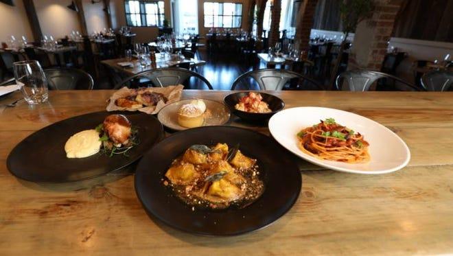 Clockwise starting on left, chicken cacciatore, onion focaccia, olive oil cake, calamari, bucatini and squash.