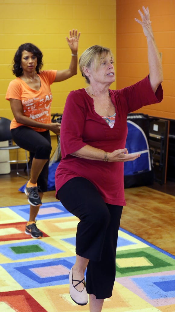 Lindsay Lawrence, bottom right, leads a tai chi class