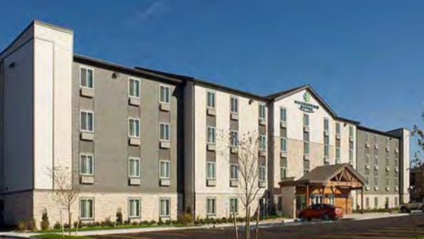 The WoodSpring Suites chain is suing Milwaukee over its proposed hotel near Mitchell International Airport.
