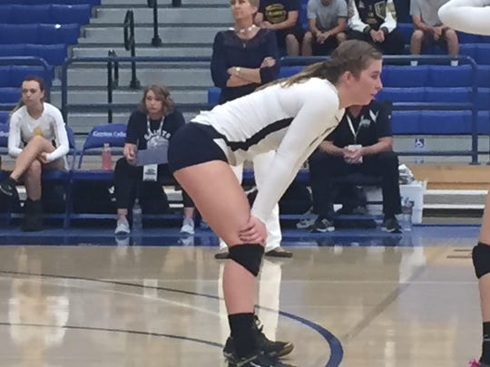 Hillcrest Christian girls volleyball coach Mary Mueller looks over the shoulder of her daughter, outside hitter Kristen Mueller, during CIF-Southern Section Division 10 final Saturday at Cerritos College.
