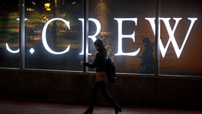 A woman walks past a J. Crew retail store in Baltimore.