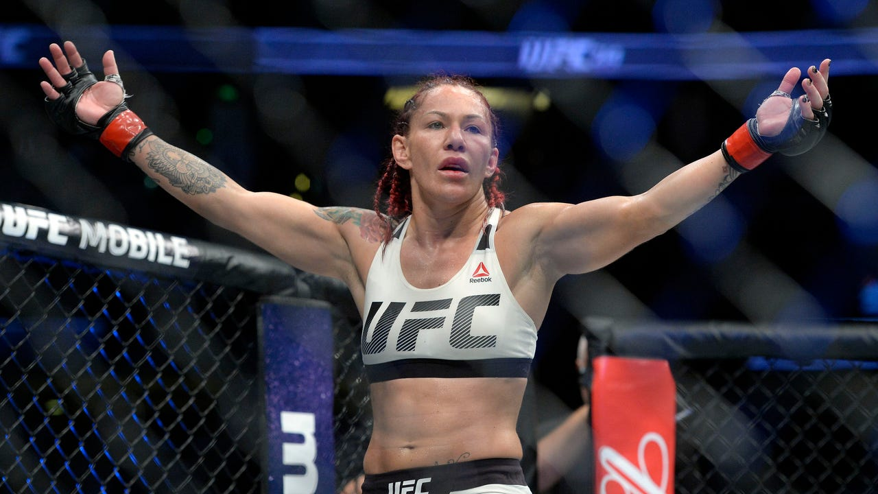 "Cristiane ""Cyborg"" Justino took care of business against Tonya Evinger to win the women's featherweight title at UFC 214."