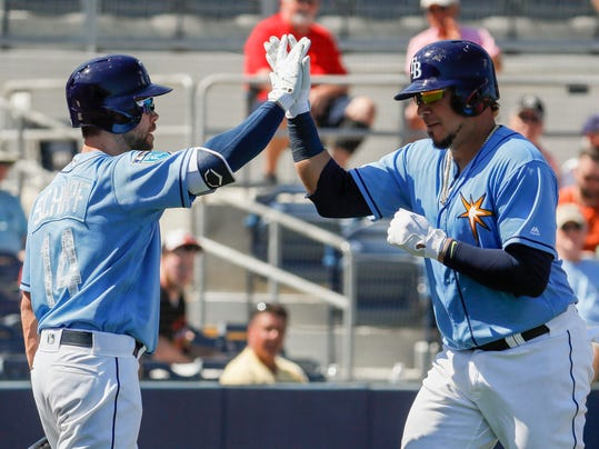 Tampa Bay Rays' Jesus Sucre celebrates with Ryan Schimpf, left, after hitting a solo home run in the second inning of a spring training baseball game against the Baltimore Orioles, Thursday, March 1, 2018, in Port Charlotte, Fla. (AP Photo/John Minchillo)