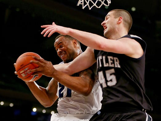 NEW YORK, NY - MARCH 12:  Gene Teague #21 of the Seton Hall Pirates grabs the rebound before Andrew Chrabascz #45 of the Butler Bulldogs during the first round of the Big East Basketball Tournament at Madison Square Garden on March 12, 2014 in New York City.  (Photo by Elsa/Getty Images)