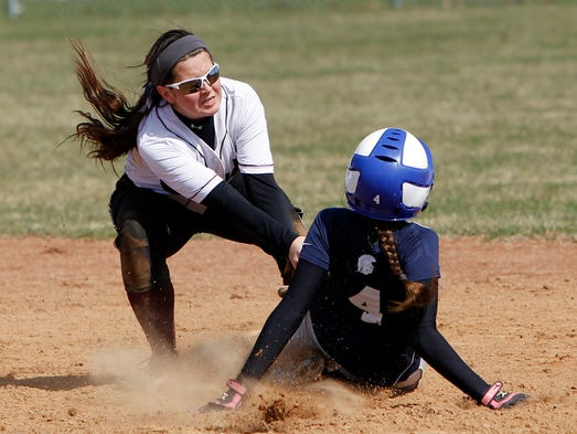 Arcadia's Amanda Dow, left, tags out Gates Chili's Rebecca Kellogg at second.
