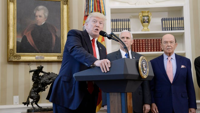 President Trump speaks about trade as Vice President Pence and Secretary of Commerce Wilbur Ross look on in the Oval Office on March 31, 2017.
