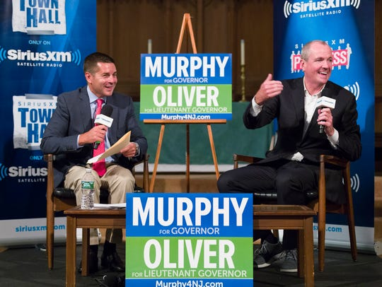 Democratic gubernatorial candidate Phil Murphy (right)