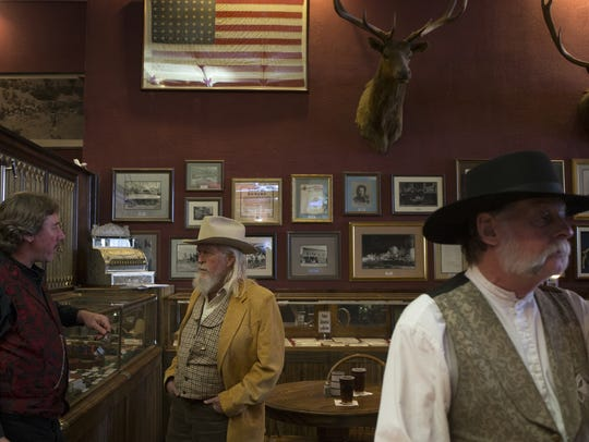 Scott Stanford (left,) general manager, talks with Bob Anderson (center), November 6, 2017, at the Palace Saloon and Restaurant 120 S. Montezuma Street, Prescott, Arizona.