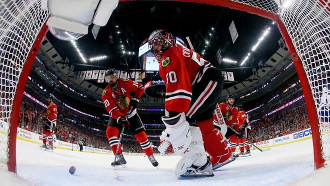 CHICAGO, IL - JUNE 08: Corey Crawford #50 of the Chicago Blackhawks reacts after a third period goal by Cedric Paquette #13 of the Tampa Bay Lightning during Game Three of the 2015 NHL Stanley Cup Final at the United Center on June 8, 2015 in Chicago, Illinois. (Photo by Bruce Bennett/Getty Images)