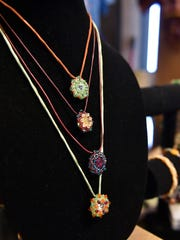 Handcrafted accessories by local artist Anne Perez were on display at I Puti'on: The Star in Hagatna on Dec. 5.